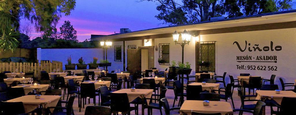 Terraza del restaurante Viñolo en Churriana
